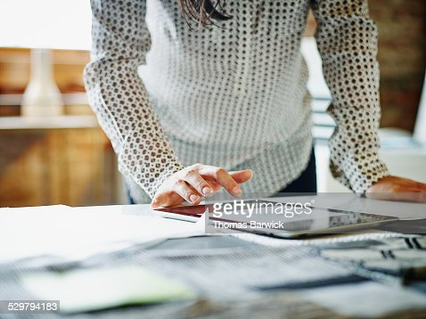 Businesswoman looking at digital tablet in office