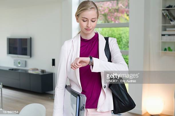 Businesswoman looking at her wristwatch