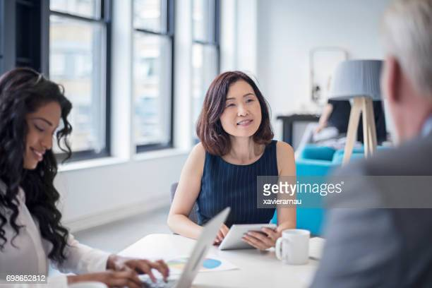 Businesswoman looking at male colleague in meeting