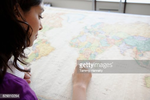 Businesswoman looking at map : Photo