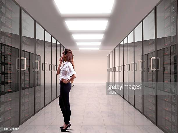 Businesswoman looking at server
