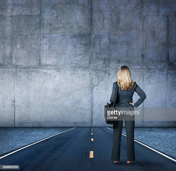 Businesswoman Looking At The End Of The Road