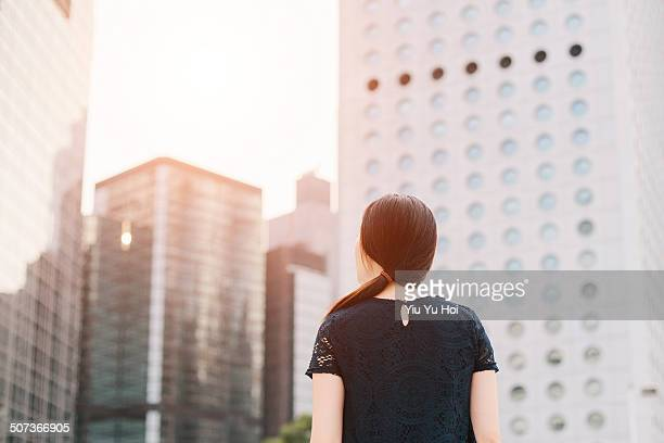 Businesswoman looking away city on fresh morning