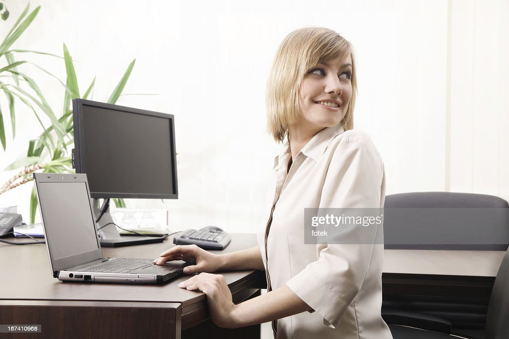 Businesswoman looking back : Stock Photo