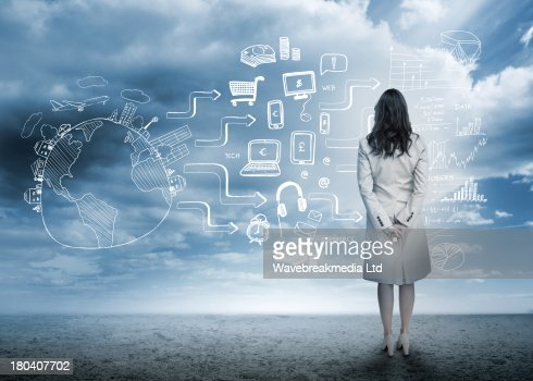 Businesswoman looking out at brainstorm drawings : Stock Photo
