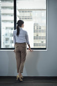 Businesswoman looking out window
