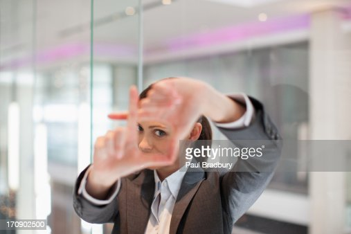 Businesswoman making framing gesture with hands
