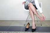 Businesswoman massaging her foot