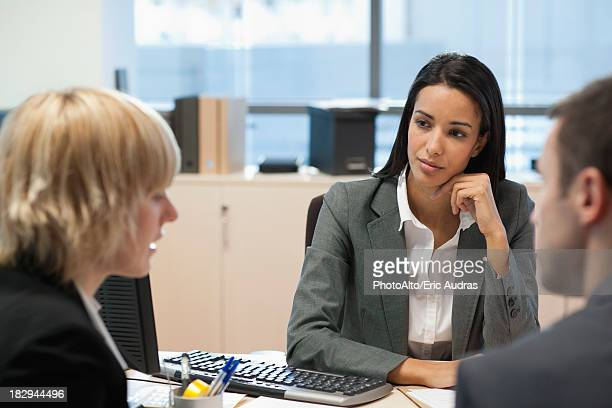 Businesswoman meeting with business partners in office