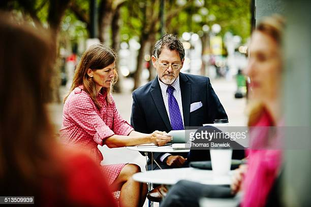 Businesswoman meeting with client at urban cafe