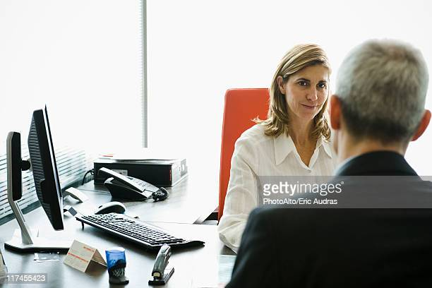 Businesswoman meeting with client in office