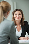 Businesswoman meeting with client