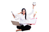 Young businesswoman multitasking isolated on white