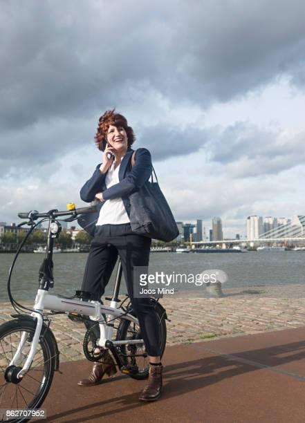 businesswoman on bike, having a phone call