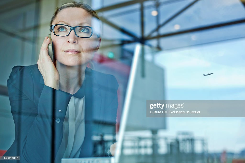 Businesswoman on cell phone in airport