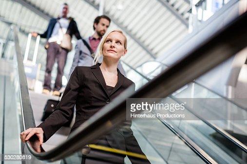 Businesswoman On Escalator At Airport