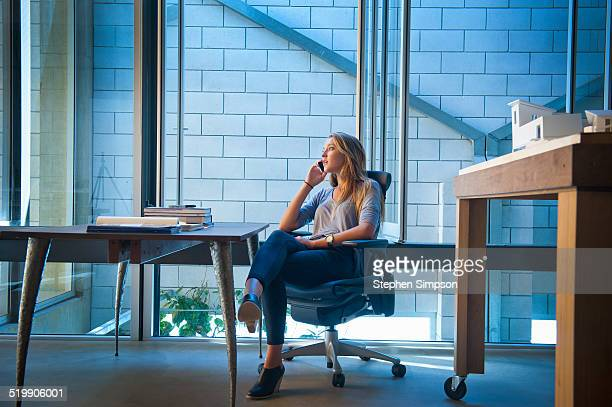 businesswoman on phone in architectural office