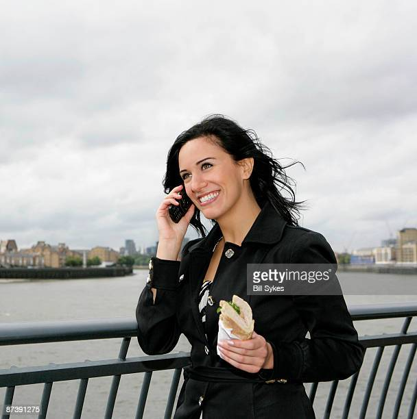 Businesswoman on phone with lunch