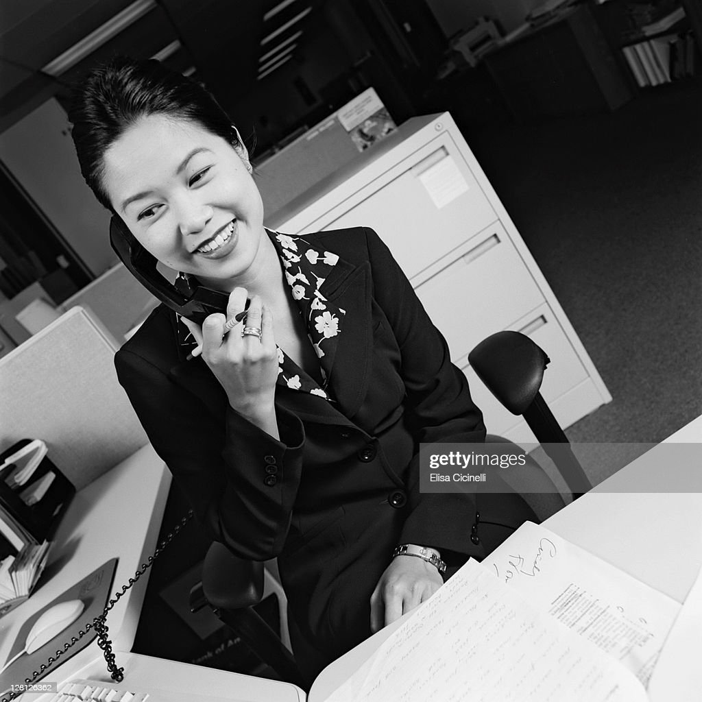 Businesswoman on telephone smiling : Stock Photo