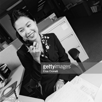 Businesswoman on telephone smiling : Stock Photo