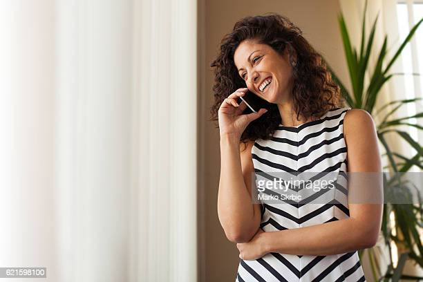 Businesswoman On The Phone In Her Office