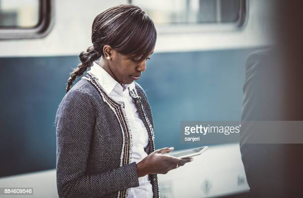Businesswoman on Train Station Using Phone