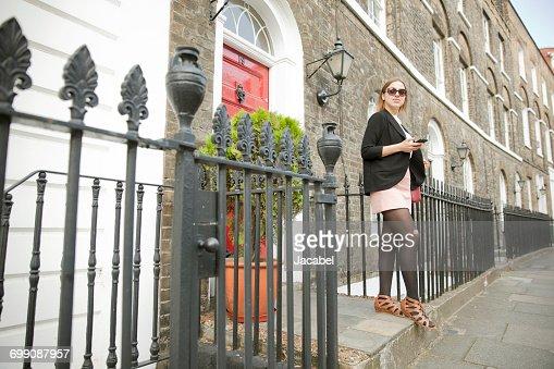 Businesswoman on way to work, London