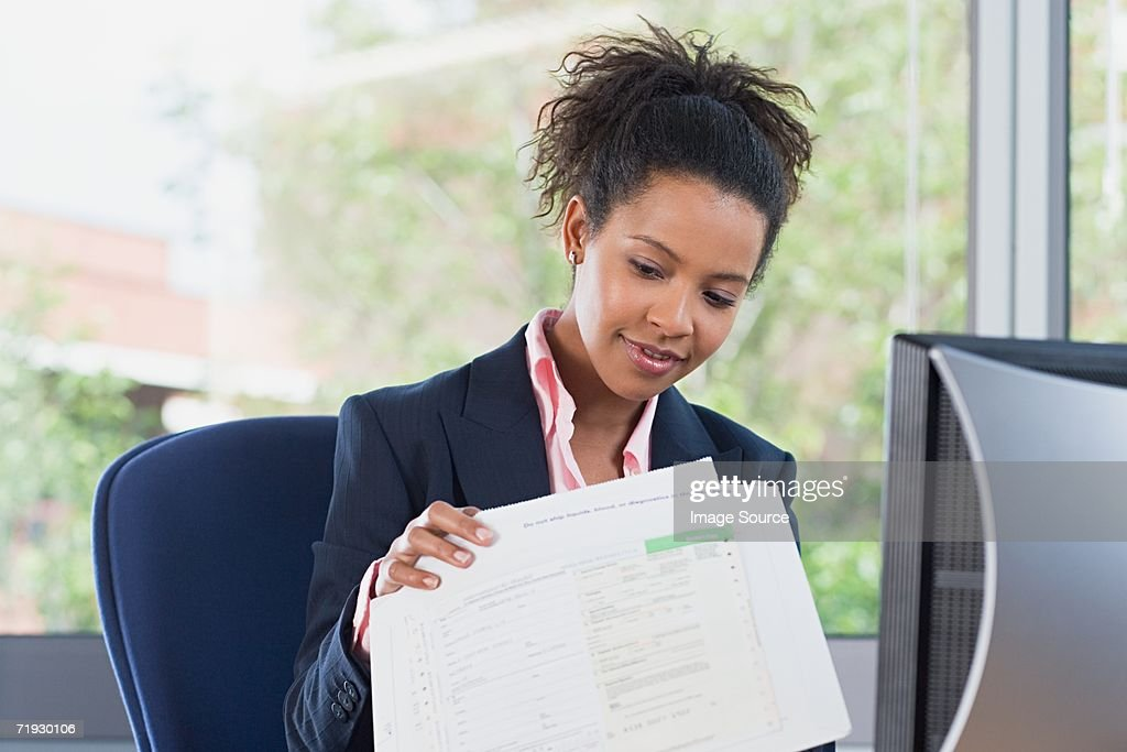 Businesswoman opening post in office : Stock Photo