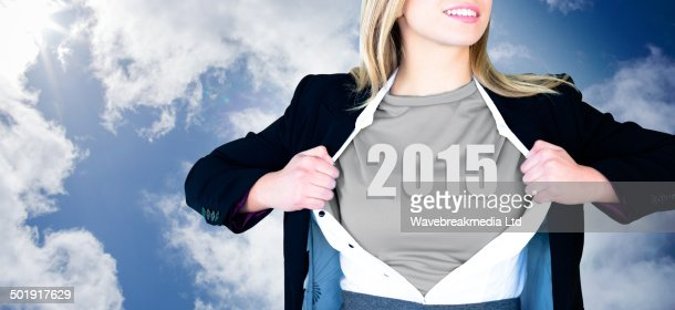 Composite image of businesswoman opening shirt in superhero style : Foto de stock