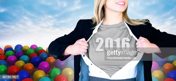 Composite image of businesswoman opening shirt in superhero style : Stock-Foto