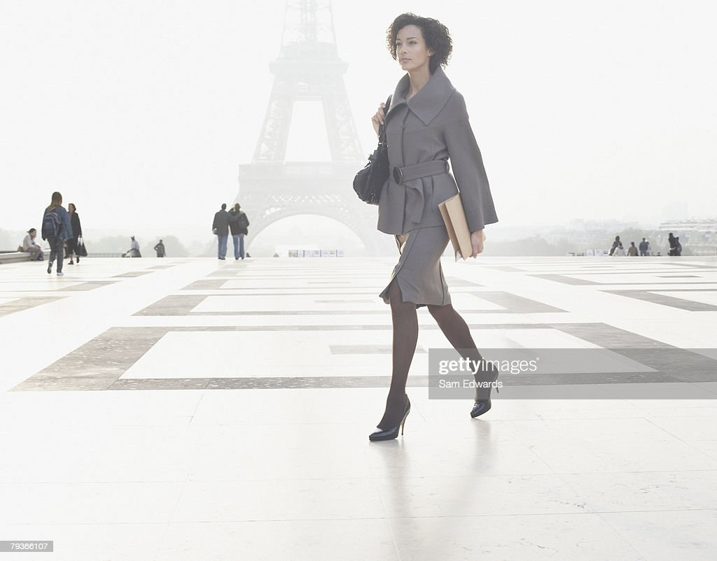 Businesswoman outdoors walking through plaza by the Eiffel Tower  : Stock Photo