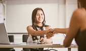 Business people partnership handshake concept.Photo two business woman handshaking process.Successful deal after great meeting. blurred background