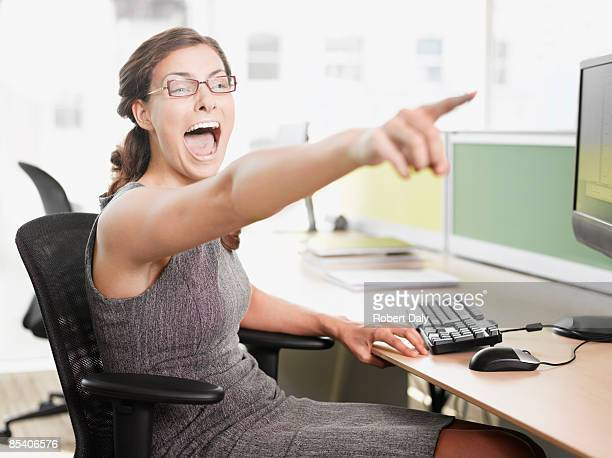 Businesswoman pointing and shouting