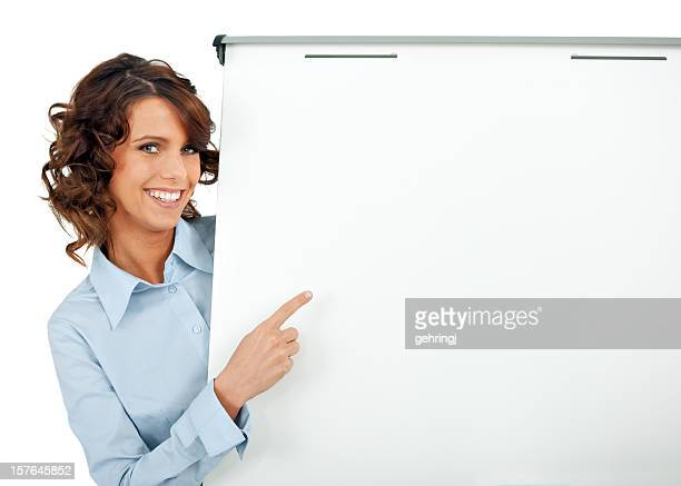 Businesswoman pointing at a white board