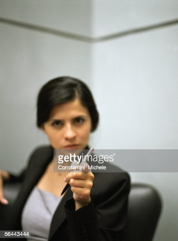 Businesswoman pointing at camera : Stock Photo