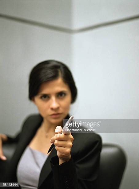 Businesswoman pointing at camera