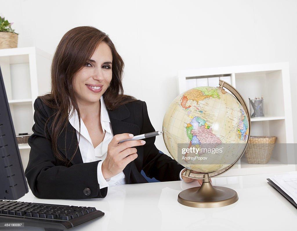 Businesswoman Pointing At Globe : Stock Photo