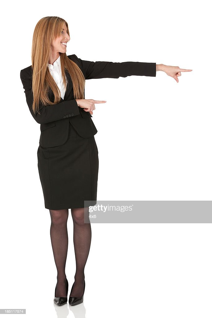 Businesswoman pointing sideways