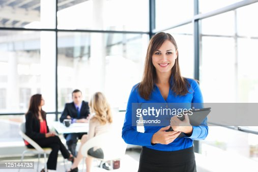 Businesswoman Portrait with Coworkers Meeting in Background, Copy Space : Stock Photo