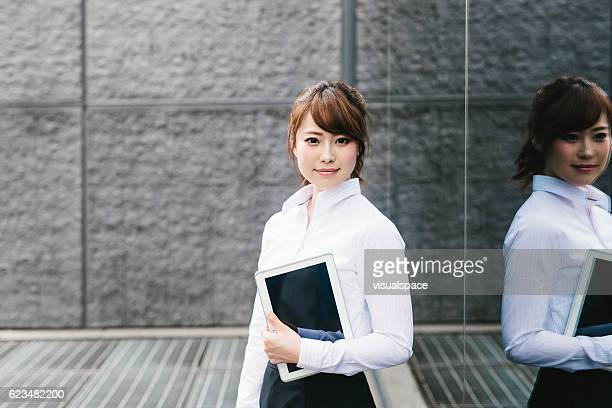 Businesswoman Posing with a Tablet