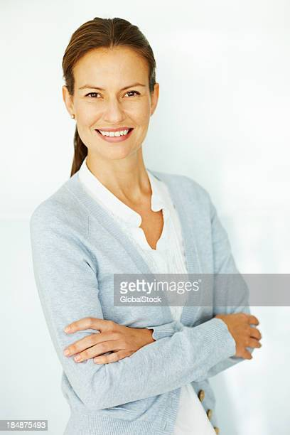 Businesswoman posing with folded hands
