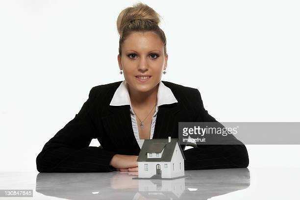 Businesswoman presenting a model house