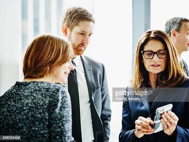 Businesswoman presenting ideas on smartphone
