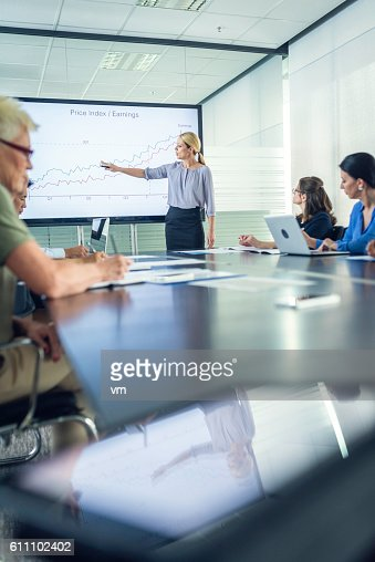 Businesswoman presenting revenue growth