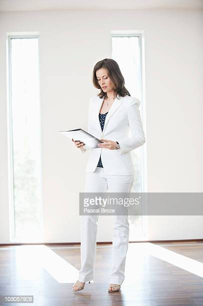 Businesswoman reading a file
