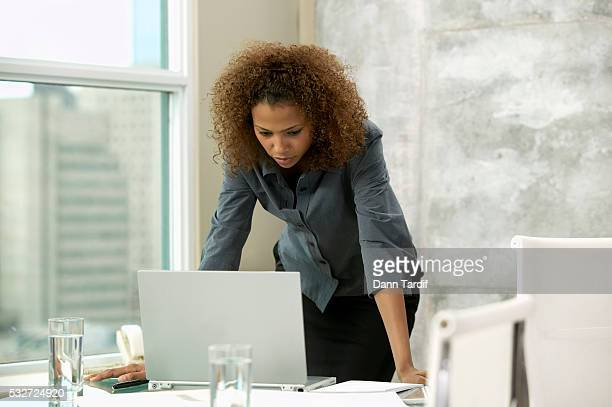 Businesswoman Reading Message on Laptop