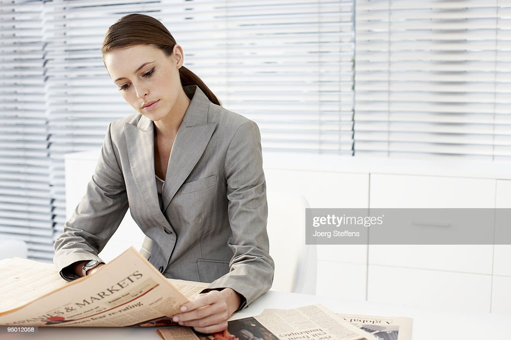 Businesswoman reading newspaper : Stock Photo