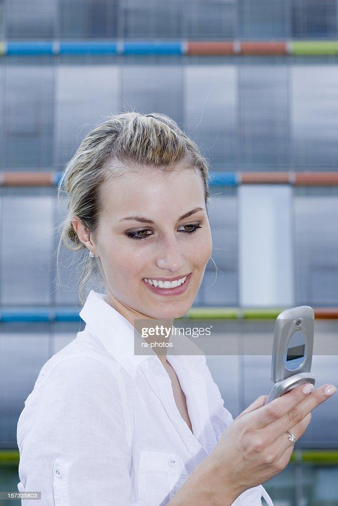 Businesswoman reading SMS : Stock Photo