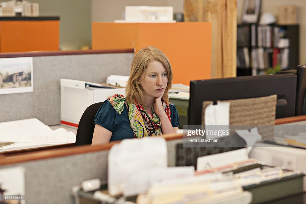 Businesswoman reads email : Stock Photo