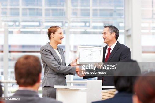 Businesswoman Receiving an Award